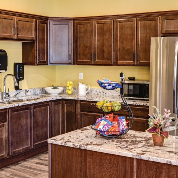 Common kitchen with beverages and snacks available around the clock