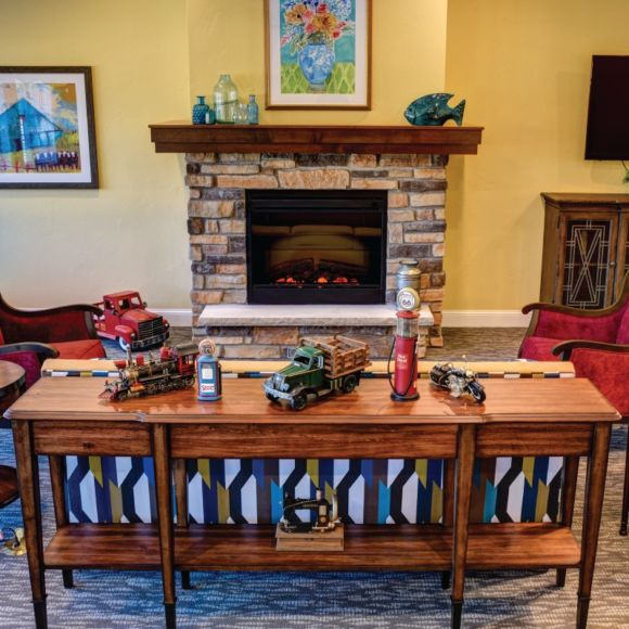 Cozy living areas with fireplaces and televisions